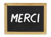 Merci (Thank you) written on a blackboard