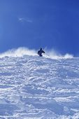 Low angle view of a person skiing against clear blue sky