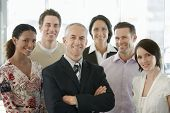 stock photo of arms race  - Group of multiethnic business people smiling in office - JPG
