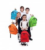 Group of happy kids with colorful school bags - back to school concept
