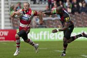 17/09/2011. Twickenham, England.  Gloucester's Charlie Sharples,  and Harlequins Ugo Monye, in actio