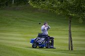 SAINT-OMER, FRANCE. 16-06-2010, A disabled golfer on a specially adapted cart the European Tour, 14t
