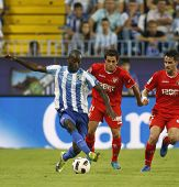MALAGA, SPAIN. 19/09/2010. Quincy Owusu-Abeyie the Malaga forward shields the ball from Lautaro Acos