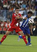 MALAGA, SPAIN. 19/09/2010.  Luca Cigarini a Sevilla midfield player fouls Eliseu the Malaga midfield