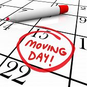 picture of possess  - The words Moving Day and a date circled on a calendar with a red marker to illustrate a reminder of an important time for relocation to a new home or place of business - JPG