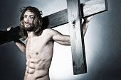 Jesus Christ of Nazareth carrying the cross.