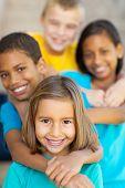happy elementary school friends outdoors