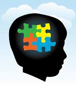 stock photo of aspergers  - A silhouette of a child with symbolic autism puzzle pieces - JPG