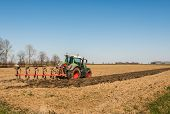 Plowing The Farmland