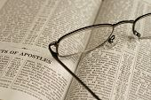 stock photo of bible verses  - A high resolution image of reading glasses on an open bible - JPG