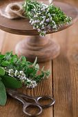 Bouquet garni - herbs  tied by string on old wooden table