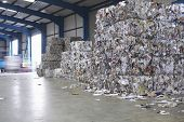 Compacted piles of paperwaste at recycling plant
