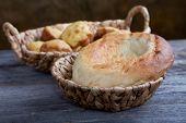 Bread In Wattled Baskets On A Table