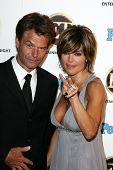 WEST HOLLYWOOD - AUGUST 27: Harry Hamlin and Lisa Rinna at the 10th Annual Entertainment Tonight Emm
