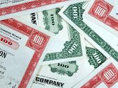 stock photo of debenture  - Red and green share certificates - JPG