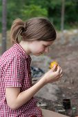 stock photo of chanterelle mushroom  - girl in the woods exploring chanterelle mushrooms - JPG