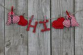 Red hearts and HI hanging on clothesline