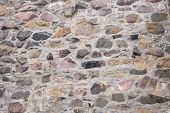picture of fieldstone-wall  - Old field stone wall background with stones of different colors - JPG