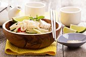 Udon noodles with vegetables and chicken in a bowl