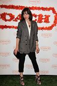 Milla Jovovich at Coach's 3rd Annual Evening of Cocktails and Shopping benefiting  the Children's De