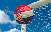 Croatia Flag And Soccer Ball In Goal Net