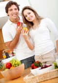 foto of healthy eating girl  - Beautiful healthy eating couple with fruits and vegetables - JPG