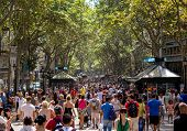 Barcelona, Spain - August 19, 2013: The Busy High Street Of La Rambla In Barcelona During The Day On