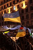 Kiev (kyiv), Ukraine - December 4, 2013: Euromaidan Protester With Flag Stands On The Barricades. Un