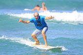 Bald italian man enjoys surfing
