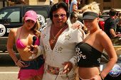 Emily Dean, an Elvis Impersonator and Vicky Thomas at the Bullrun Rally 2004 in Hollywood, California. 06-05-04