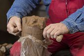 foto of loam  - hands of potter do a clay pot - JPG