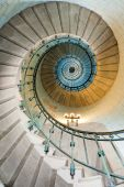 stock photo of spiral staircase  - high luxurious lighthouse staircase with metal guardrail and opaline walls Eckmul Brittany - JPG