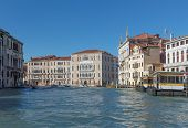Riding On A Gondola On Canal In Venice