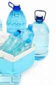 Water in different bottles in cooling bag isolated on white