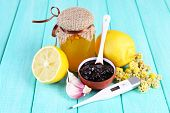 stock photo of home remedy  - Folk remedies for colds on wooden table - JPG