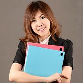 Asian Businesswoman Give A Folder And Smile