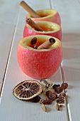 stock photo of cider apples  - Homemade warm apple cider in apple cups
