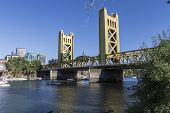 SACRAMENTO, CALIFORNIA - July 4, 2014:  Holiday boat users gather near the historic Tower Bridge in