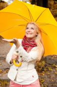 young beautiful autumn woman under umbrella