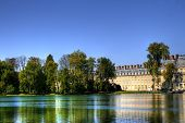 View of the Chateau de Fontainebleau and its reflection across a tranquil lake, situated close to Pa