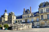 View of the Chateau de Fontainebleau and its famous stairway, situated close to Paris it introduced