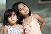 SIQUIJOR ISLAND, PHILIPPINES, DECEMBER 21, 2013: Two unidentified Filipino little girl sisters posin