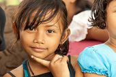 BUKIT LAWANG, INDONESIA, JULY 07, 2010: Unidentified little girl posing among her friends in the Buk