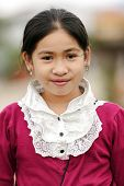 VANG VIENG, LAOS, MARCH 18, 2011: Portrait of a Laotian little girl wearing traditional clothes in t