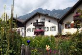 Traditional houses and garden with flowers in Garmisch-Partenkirchen