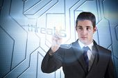 Businessman pointing to word threats against circuit board on futuristic background