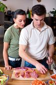 Young Couple Preparing Lunch In Kitchen