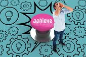 The word achieve and shouting casual man standing against pink push button