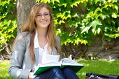 Pretty Female Universtity Student Studying Outdoor