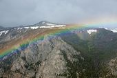 foto of beartooth  - A rainbow over the Beartooth Pass in Montana - JPG